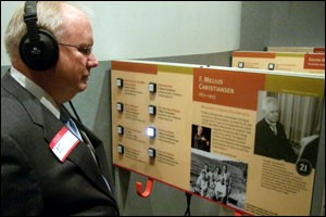 Bob Johnson listens to St. Olaf F. Melius Christiansen's listening exhibit at the MN 150 celebration.