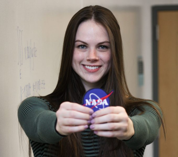 Student Emily Schlieff Holding NASA Patches