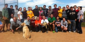 2014 Greek vs. Latin softball game participants pose for photo.