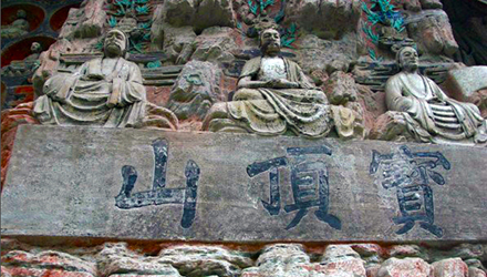 Statues and Chinese writing on hillside