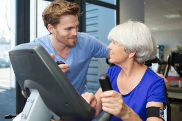 therapist with senior woman exercising