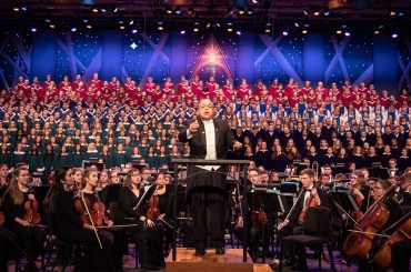 Dr. Anton Armstrong conducts the Massed Choirs and St. Olaf Orchestra during the 2019 Christmas Festival