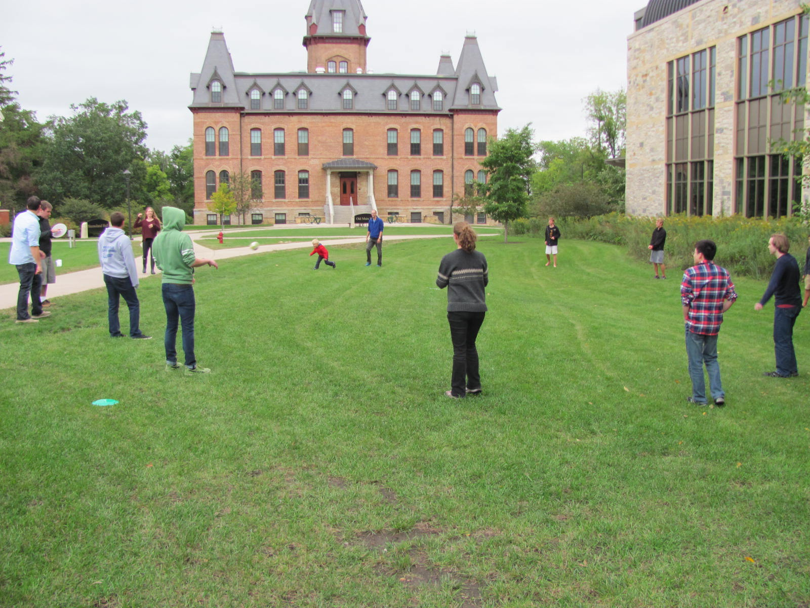 Playing ball on the lawn in front of the science building.