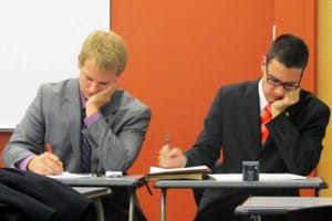 St. Olaf students Kevin George '13 (left) and Alex Everhart '15 prepare their arguments for a recent debate competition. The two placed second out of 41 teams at the Pi Kappa Delta Nationals tournament.