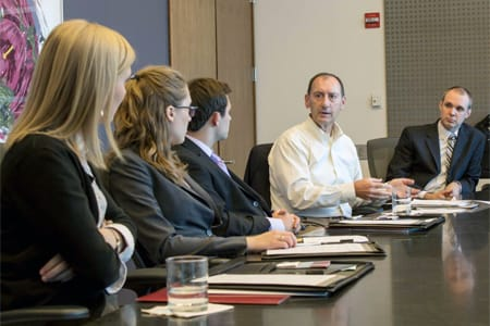 Kirk Stubbee '77, a regional claims executive at AIG, talks to students in Chicago as part of the Piper Center's Connections Program.