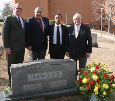 St. Olaf Vice President for Enrollment and College Relations Michael Kyle '85, St. Olaf Choir Conductor Anton Armstrong '78, Tuskegee University Golden Voices Choir Conductor Wayne Barr, and St. Olaf Music Organizations Manager Bob Johnson place flowers on the grave of legendary composer William Dawson.