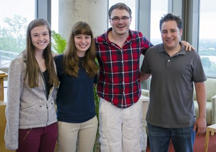 St. Olaf students (from left) Rachel Bash '15, Katie Berg '15, and Brandon Cash '16 are working with Assistant Professor of Psychology Jeremy Loebach (right) on two separate projects researching training methods for cochlear implant users this summer — Bash and Cash through the CURI program, and Berg through a Magnus the Good Fellowship.