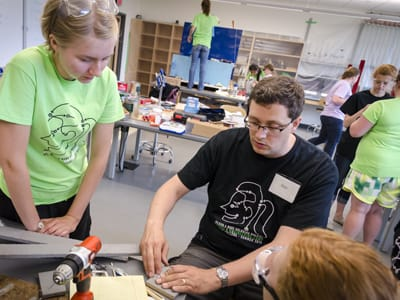 St. Olaf Associate Professor of Physics Jason Engbrecht helps participants in the college's summer Physics and Engineering Camp for Girls.