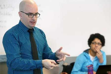 A photo of Joshua Anderson teaching his class based on the TV drama, 'The Wire.'