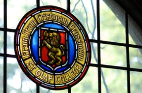 an image of the colorful stained glass seal as seen in Rolvaag Library