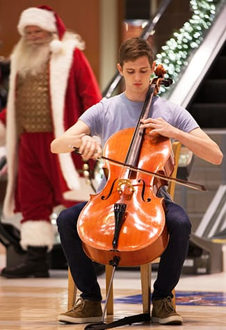 "Sam Viguerie '17 performs ""Beautiful Savior"" — a deeply moving arrangement by St. Olaf Choir founder F. Melius Christiansen — at the beginning of a recent Christmas Festival pop-up performance at Southdale Center. Watch the performance here."